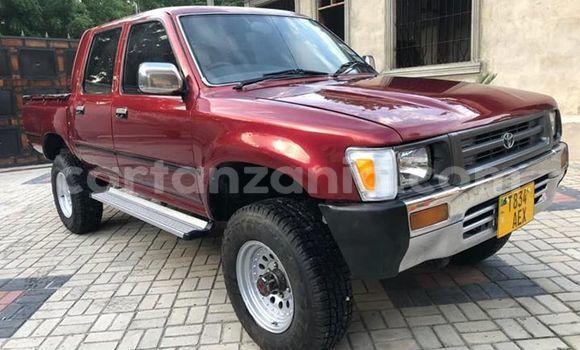 Buy Used Toyota Hilux Red Car in Dar es Salaam in Dar es Salaam