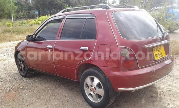 Buy Used Toyota Starlet Red Car in Dar es Salaam in Dar es Salaam